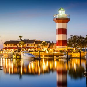 Hilton Head, South Carolina, USA lighthouse on the coast at twilight.